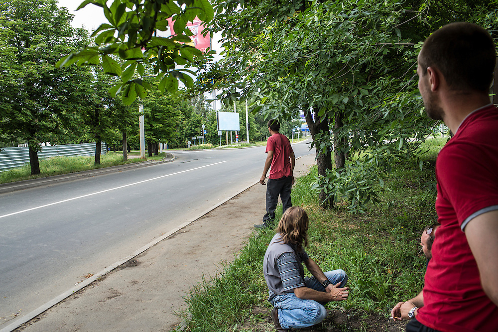 DONETSK, UKRAINE - MAY 27: Men react to the sound of gunfire just outside the airport, scene of a violent battle the previous day, on May 27, 2014 in Donetsk, Ukraine. After businessman Petro Poroshenko won Sunday's presidential election in Ukraine, the military has been cracking down on pro-Russian separatist fighters. (Photo by Brendan Hoffman/Getty Images) *** Local Caption ***