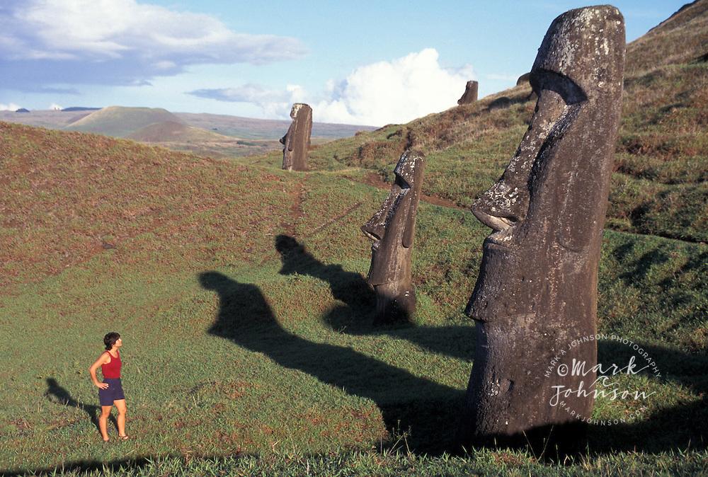 Woman looking at the Moai at Rano Raraku, Easter Island