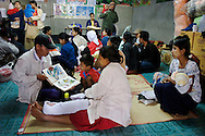 Mums and their children attend a meeting to receive advice and  information about maternity and health care at Mae Tao Clinic, on December 20 of 2006, in Mae Sot area, Thailand. The clinic has a program to educate migrants and refugees about health care..The Mae Tao Clinic was founded on 1988 by Dr. Cynthia Maung and gives medical care for migrant and refugees, fleeing Burma, in the Mae Sot area, Thailand..Burma has since 1962 been ruled by dictator Burman Regimes. Pro democrats and minority ethnics have since been object of human rights abuses and armed minority groups has appeared, bringing a state of Civil War..This has forced Burmese people to flee their villages and on their arrival to Thailand many suffer from malnutrition, illnesses and injuries, amputations from land-mines or traumas. The Mae Tao Clinic supported by donors and volunteers provides with free health care and treatment to these people.