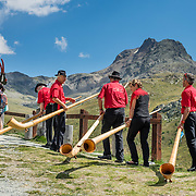 "Hear an alpenhorn concert at Alp Languard, reached via chairlift above Pontresina in Upper Engadine, in Graubünden (Grisons) canton, Switzerland, the Alps, Europe. The Swiss valley of Engadine translates as the ""garden of the En (or Inn) River"" (Engadin in German, Engiadina in Romansh, Engadina in Italian). For licensing options, please inquire."