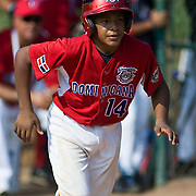 Dominican Republic catcher Jorge Mercedes (#14) takes first base after being hit by a pitch in the top of the sixth inning, The Dominican Republic would go on to defeat Australia 7-2 at 2010 Aberdeen Baseball Tournaments in Aberdeen MD.