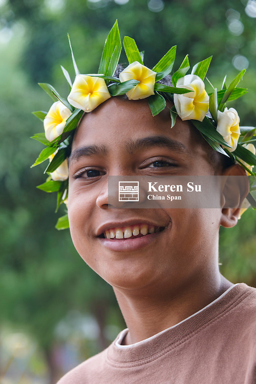 Yapese boy wearing flower wreath at Yap Day Festival, Yap Island, Federated States of Micronesia