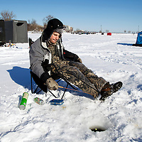Ice fishing   on Lake Monona Bay in Madison, Wisconsin.