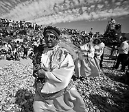 A woman dressed as a saint follows the procession in São Bartolomeu do Mar. The procession to thank the Saint incorporates hundreds of extras and large litters, which reconstruct biblical episodes. This tradition that dates back to the sixteenth century (1566), and it claims the devil is on the loose during this day. Every year on 24 August  faith and tradition join thousands of people at the feast of St. Bartolomeu do Mar, for ritual that mixes the sacred and the profane.