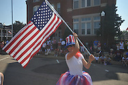 Holli Ratcliffe waves a flag in the 4th of July parade in Oxford, Miss. on Monday, July 4, 2011.