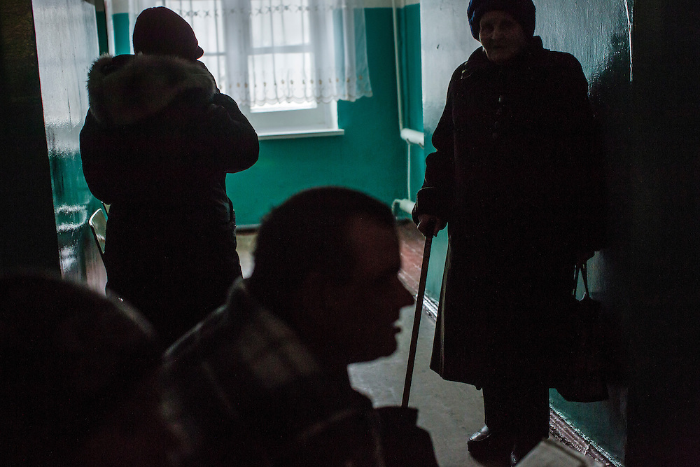 ZIMOGORYE, UKRAINE - MARCH 15, 2015: Patients wait in the hallway to see a doctor at Zimogoryivskaya Ambulatory in Zimogorye, Ukraine. CREDIT: Brendan Hoffman for The New York Times