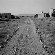 A view of the main road that leads through the residential buildings at Tarnak Farms, the al Qaeda base, training camp and pre 9/11 al Qaeda headquarters in Kandahar, Afghanistan which served as a home to Osama Bin Laden and numerous al Qaeda fighters located outside Kandahar City. It is believed that this base was where the plan for the 9/11 attacks originated, as a result Tarnak Farms was heavily bombed by the United States after September 11, 2001. (Credit Image: © Louie Palu/ZUMA Press).