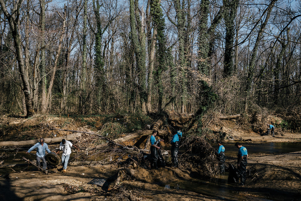 Rodney Stotts, executive director and raptor coodinator at Wings over America, a sister organization of Earth Conservation Corps, helps with the annual Lower Beaverdam Creek cleanup in Hyattsville, Md. on March 17, 2016. The cleanup, joined by a group of alternative college spring breakers, hauled everything from tires to large electronics from the water.