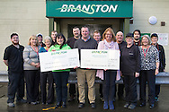 Branston Potatoes Ltd, Abernethy, Scotland. Seen here is General Manager, Kevin Imrie presenting cheques to Isla Dewar from Macmillan Cancer Support and Fiona Dennis from SCAA. Funds were raised by staff at a variety of events held throughout the year.
