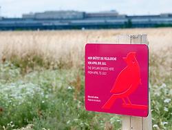 Sign warning of breeding Skylark birds at Tempelhofer Park , former Tempelhof Airport in Berlin Germany