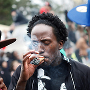 SHOT 4/20/11 4:41:33 PM - Marijuana enthusiasts light up in unison at 4:20pm at the 420 Rally in Denver, Co. They converged upon Denver, Colorado and Civic Center Park for an event that has come to symbolize Colorado's burgeoning claim as the nation's cannabis capital. Denver's annual April 20th pro-marijuana smoke-out -- known as the 420 Rally -- is reputedly the largest of its kind in the world on a day that has come to be regarded as a ganja holiday. The crowd was estimated at about 10,000 participants and the signature moment of the rally occurred at 4:20 p.m., when participants collectively lit up and a thick cloud of marijuana smoke rose over the park within site of the state capital. Organizers say the goal of the rally is to bring people together to protest peacefully marijuana prohibition. (Photo by Marc Piscotty / © 2011)