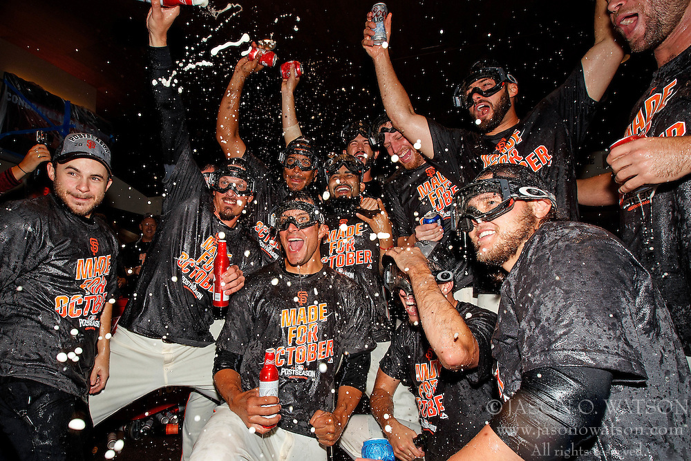 SAN FRANCISCO, CA - OCTOBER 02: The San Francisco Giants celebrate in the clubhouse after the game against the Los Angeles Dodgers at AT&T Park on October 2, 2016 in San Francisco, California. The San Francisco Giants defeated the Los Angeles Dodgers 7-1 to advance to the National League Wild Card game. (Photo by Jason O. Watson/Getty Images) *** Local Caption ***