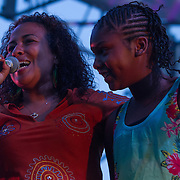 Chandra Pitts, Left, addresses the audience during The 19th Annual Bob Marley People's Festival Saturday July 27, 2013, at Tubman-Garrett Riverfront Park in Wilmington Delaware.