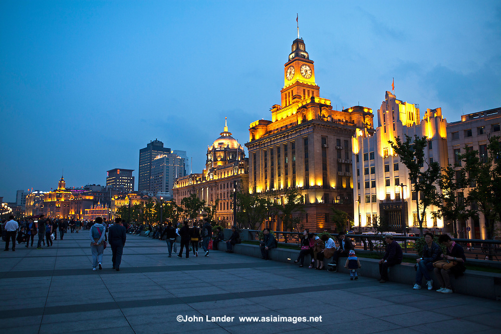 The Bund is a waterfront area in Shanghai within the former Shanghai International Settlement, which runs along the western bank of the Huangpu River, facing Pudong. The Bund usually refers to the buildings and wharves on this section of the road - thanks to its unique architecture the Bund is one of the most popular destinations in Shanghai. The Bund has dozens of historical buildings facing the Huangpu River that once housed banks and trading houses from the United Kingdom, France, the United States, Italy, Russia, Germany, Japan, the Netherlands and Belgium.  This was initially a British settlement; later the British and American settlements were combined in the International Settlement. A building boom at the end of 19th century and beginning of 20th century led to the Bund becoming a major financial hub of East Asia.  The two featured buildings to the left and center are the Shanghai Pudong Development Bank, formerly Hong Kong Shanghai Bank building.  The building in the center is the Shanghai Customs House.