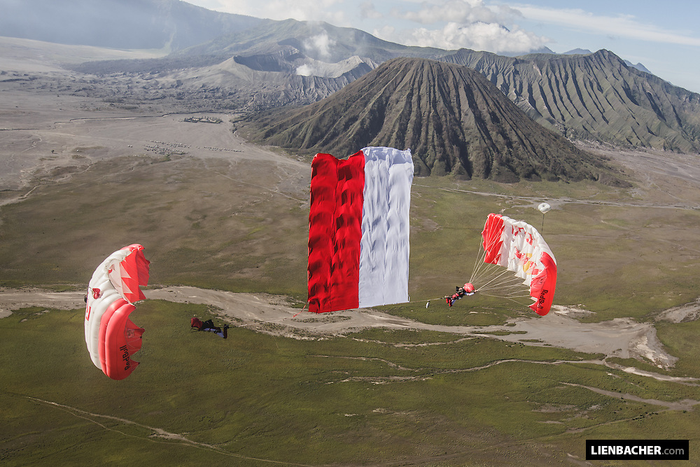 Dominic Roithmair and Marco Fuerst of the Red Bull Skydive Team perform a down-plane flag jump at Mt Bromo in Indonesia, February 28th 2015