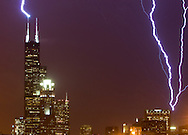 During a freak January thunderstorm, lightning bolts hit both the Sears Tower and the John Hancock Building in the same moment.