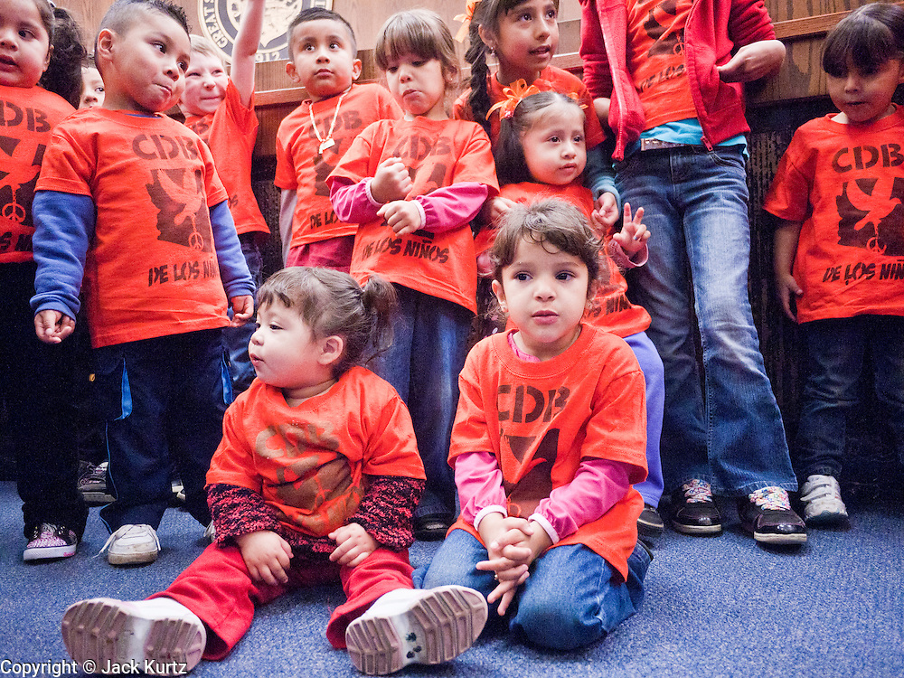22 FEBRUARY 2011 - PHOENIX, AZ:  Children formed a backdrop for a press conference on immigrants' rights and Sen Russell Pearce's anti-immigrant legislation at the State Capitol in Phoenix Tuesday. Hundreds of people including supporters of immigrants' rights, supporters of border defense, motorcycle riders and members of the Tea Party, converged on the capitol to express their views on bills. PHOTO BY JACK KURTZ