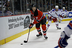 Feb 20, 2007; East Rutherford, NJ, USA; New Jersey Devils defenseman Paul Martin (7) moves past New York Rangers forward Pascal Dupuis (61) during the second period at Continental Airlines Arena in East Rutherford, NJ.