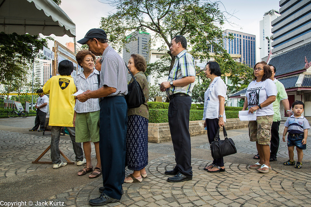 03 MARCH 2013 - BANGKOK, THAILAND: <br /> People stand in line to vote at a polling place in Benchasiri Park in Bangkok. Bangkok residents went to the polls Sunday to elect a new governor. Voter turnout was expected to be heavy for a local election. Pongsapat Pongchareon, the Pheu Thai candidate is thought to hold a slight lead over Sukhumbhand Paribatra, the Democrats' candidate. There are a total of 25 candidates in the election but only Pheu Thai and the Democrats are given a chance of winning.     PHOTO BY JACK KURTZ