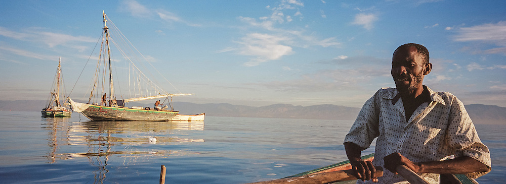 Fisherman Jean Claude Joseph rows the boat in which he fishes on Monday, December 15, 2014 in Port-au-Prince, Haiti.