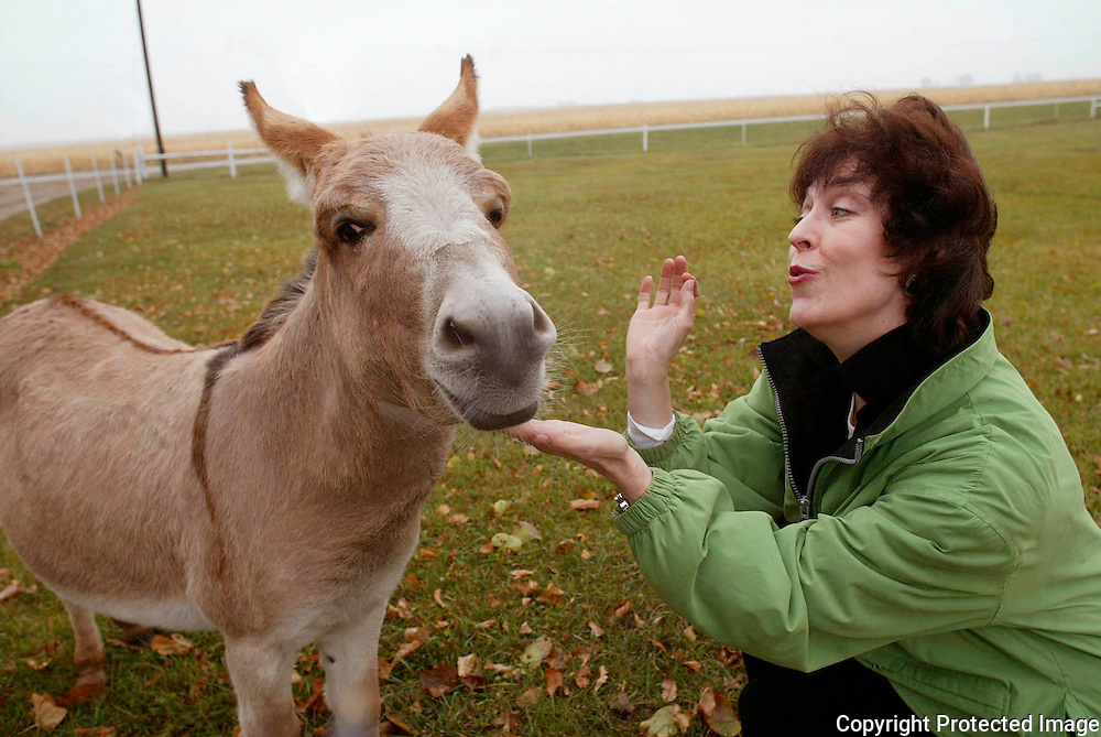 "Opera singer Jane Thorngren sings to her miniature donkey, Sebastian, on her family farm near Pilot Mound, Ia.   ""He's my sweetheart,"" said Thorngren, of the four year-old family favorite.  ""My mom loved him, and he always greeted her in the morning.""  Thorngren, an opera singer, has performed all over the world."