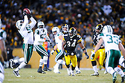 PITTSBURGH, PA - JANUARY 23: Josh Mauga #58 of the New York Jets intercepts a tipped pass against the Pittsburgh Steelers in the AFC Championship Playoff Game at Heinz Field on January 23, 2011 in Pittsburgh, Pennsylvania(Photo by: Rob Tringali) *** Local Caption *** Josh Mauga