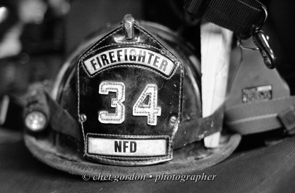 Newburgh firefighter Jason Blackwell's helmet sits on the seat of Ladder Truck #1 in the firehouse in Newburgh, NY on Friday night, July 1, 2011. The Newburgh Fire Department responds to nearly 3,000 calls a year.  © www.chetgordon.com/blog