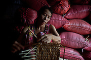 Luong Thi Lien spends part of her day weaving baskets made of water hyacinth, an indigenous and plentiful plant of the Mekong Delta region. In cooperation with local NGO Anh Duong, and its international parnter, Vietnam Plus, the baskets created are sold in stores in Ho Chi Minh City, and the funds are recirculated through the project.
