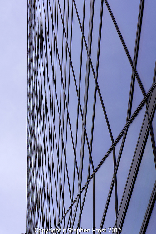 Abstract patterns made by the glass surface and edge of a modern office block.<br />