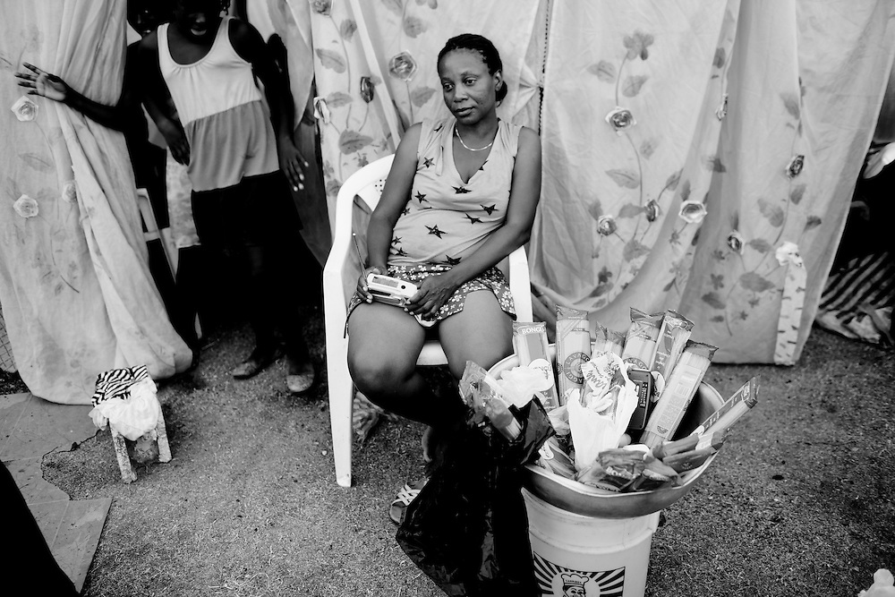 A woman sits in a camp for those displaced by the recent earthquake in Petionville, outside Port-au-Prince, Haiti.