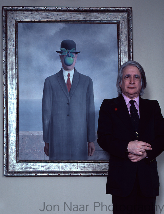 """Harry Torczyner, Magritte's attorney and model stands in front of Magritte painting of man with apple given to him by the artist in exchange for legal services.  Published in """"Connoisseur Magazine"""", December 1982. Taken with a 35 mm Nikon FM."""