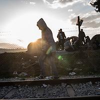 A migrant walking on the rail road track not far from the Greek Macedonian border, Idomeni, Greece. FEDERICO SCOPPA/CAPTA