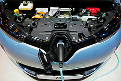 Detail of Renault Zoe electric car with plug-in charging cable attached at Paris Motor Show 2012