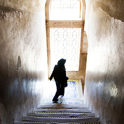 Iranian woman walking down the stairs, Isfahan, Iran
