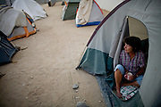 RENO, NV - OCTOBER 6:  Barbara Lehman sits in the tent she calls home in a tent city for the homeless in downtown Reno, Nevada October 6, 2008. Lehman lost her job in July after a broken arm left her unable to work. The City of Reno set up the tent city when existing shelters became overcrowded as Nevada struggles with one of the highest unemployment rates in the country. (Photo by Max Whittaker/Getty Images)