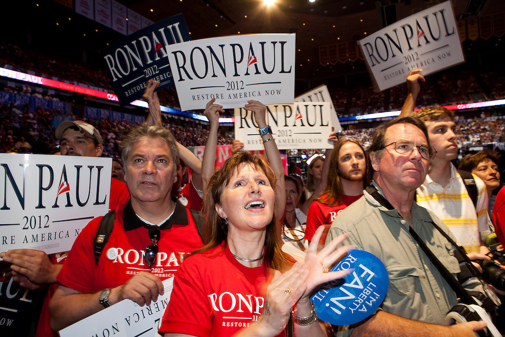 Supporters of Republican presidential hopeful Ron Paul cheer as their candidate speaks at the Iowa Republican Straw Poll on Saturday, August 13, 2011 in Ames, IA.
