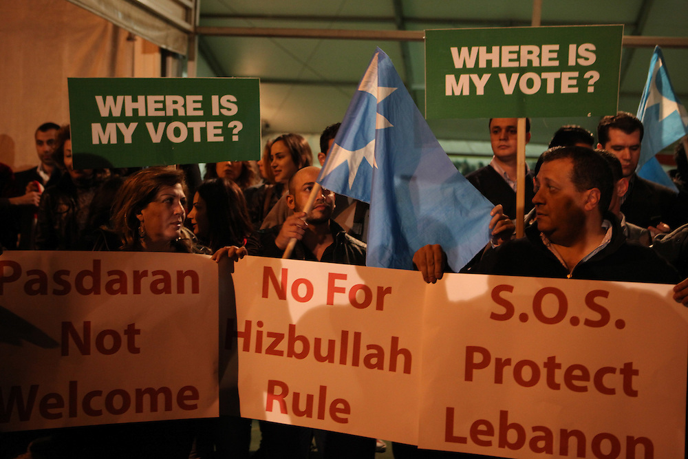 Small protests broke out in various areas around Lebanon after consultations were held on Monday with member of parliament, Najib Mikati, appearing as the front runner to replace Saad Hariri. Mikati is the choice of the March 8 coalition, which includes the Lebanese resistance and political movement Hizballah. March 8 collapsed the Lebanese government over a week ago as the UN tribunal investigating the killing of former Prime Minsiter, Rafiq Hariri, Saad's father, gets set to release indictments which are expected to target members of Hizballah. In Beirut a small protest was held at the grave of Rafiq Hariri, and elsewhere tires were burned shutting down roads by Saad Hariri's supporters.///Around 100 supporters of former prime minister Saad Hariri gathered outside the grave of Rafiq Hariri, Saad's father, in downtown Beirut. Many chanted against Iran, a supporter of Hizballah and the March 8 movement.