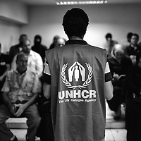 Egypt / Syrian refugees / Senior Community Service Assistant with UNHCR Raef Goubrail counsels applicants as hundreds of Syrian refugees register for protection and other social services at UNHCR offices in the Zamalek neighborhood in Cairo, Egypt, Tuesday, May 28, 2013. Many Syrian refugees fled the violence in their homeland and were displaced to neighboring countries, including Egypt. The Ministry of Foreign Affairs estimates that there may be almost 150,000 Syrian refugees in Egypt, most of whom reside in the cities of Cairo and Alexandria.  / UNHCR / Shawn Baldwin / May 2013