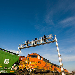 A westbound BNSF intermodal train has just left the yard in Cicero, IL to begin it's journey to Portland, OR under a brilliant blue sky.
