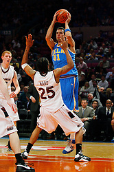 Nov 21, 2008; New York, NY, USA; UCLA Bruins forward Nikola Dragovic (41) draws a charge on Southern Illinois Salukis guard Ryan Hare (25) during second half action of the 2K Sports Classic consolation game at Madison Square Garden. UCLA defeated Southern Illinois 77-60.