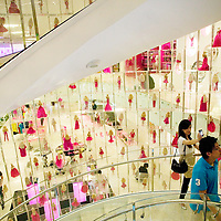 SHANGHAI, JUNE-14 :  visitors walk up a giant staircase inside the newly opened Barbie store.