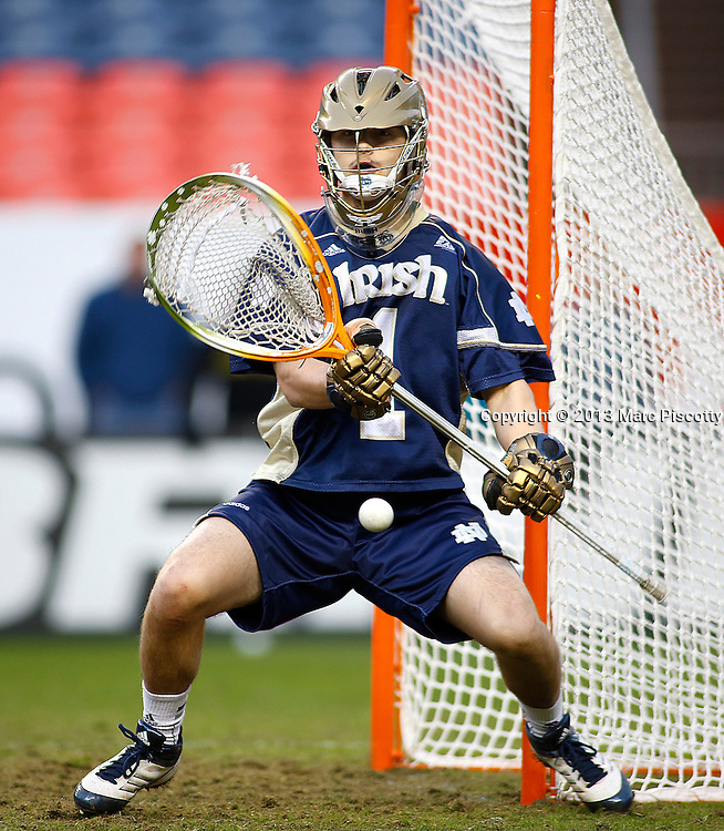 SHOT 3/16/13 5:32:24 PM - Notre Dame goalkeeper John Kemp #1 faces a shot during their college lacrosse game against Denver at the Whitman's Sampler Mile High Classic at Sports Authority Field at Mile High in Denver, Co. on Saturday March 16, 2013. Notre Dame won the game 13-12 in overtime. (Photo by Marc Piscotty / © 2013)