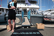 A representative of Burgess Yachts waits for customers during the Antibes Yacht Show. The second year of the Antibes Yacht Show gathers brokers and clients in the historic Port Vauba, in Antibes, France, on Saturday, April 19, 2008.