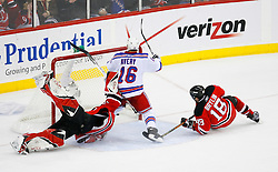 April 9, 2008; Newark, NJ, USA; New York Rangers left wing Sean Avery (16) scores a goal against New Jersey Devils goalie Martin Brodeur (30) during the third period of game 1 of the Eastern Conference Quarterfinal playoffs at the Prudential Center in Newark, NJ.  The Rangers defeated the Devils 4-1 to take a 1-0 lead in the best of 7 series.