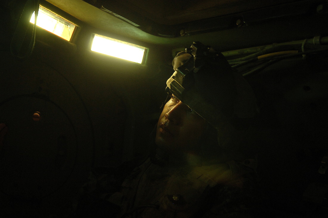 SGT John Christoffersen from Bravo Company, 2nd Battalion, 6 Infantry Regiment, 1st Armored Division, Baumholder, Germany, heads back to base on September 2, 2006, in a Bradley after conducting an early morning raid, looking for weapon caches on a local school, and several houses in the Tameem district of Ramadi, Iraq, during Operation Caribbean Stud. No significant evidence was found. The mission is part of the continuing support of the 1-1 Armored Division. 1-1AD is deployed with 1st Marine Expeditionary Force (Forward) in support of Operation Iraqi Freedom in the Al Anbar province of Iraq (Multi National Forces-West) to develop the Iraqi security forces, facilitate the development of official rule of law through democratic government reforms, and continue the development of a market based economy centered on Iraqi reconstruction. — © /