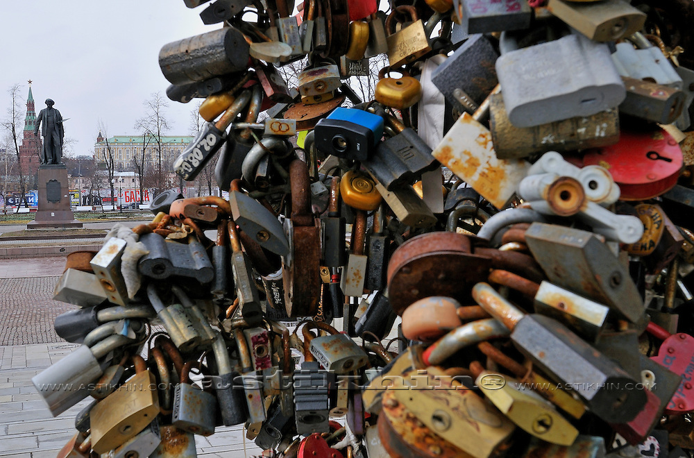 Locks on Luzhkov Bridge, Monument of Ilya Repin and Vodovzvodnaya Tower in Kremlin.