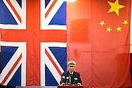 Rear Admiral Chuan Shu Zhang speaks to the media aboard the Chinese Naval assault ship Chang Bai Shan at Portsmouth Royal Navy Base today. The ship is involved in the first visit by the Chinese Navy to the UK since 2007 and the largest ever. She is accompanied by the frigate Yun Cheng and the replenishment ship Chaohu. The ships arrived in Portsmouth 24 hours early due to the expected bad weather. The Royal Navy statement stated that the five day formal visit is aimed at enhancing military understanding between the UK and China. Picture date Monday 12th January, 2015.<br /> Picture by Christopher Ison. Contact +447544 044177 chris@christopherison.com