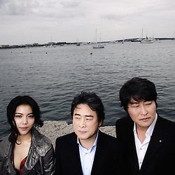 """From left to right: Ok-bin Kim, Park Chan Wook and Kang-ho Song presenting their movie """"Thirst"""" (Bakjwi) at the Cannes Film Festival. France. May 2009. Photo: Antoine Doyen"""