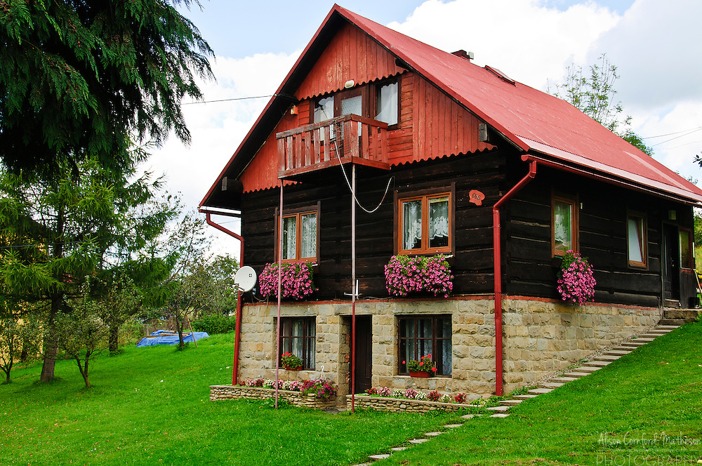 A small rural home in the village of Istebna in Poland overlloks the Silesian Beskids mountain range.