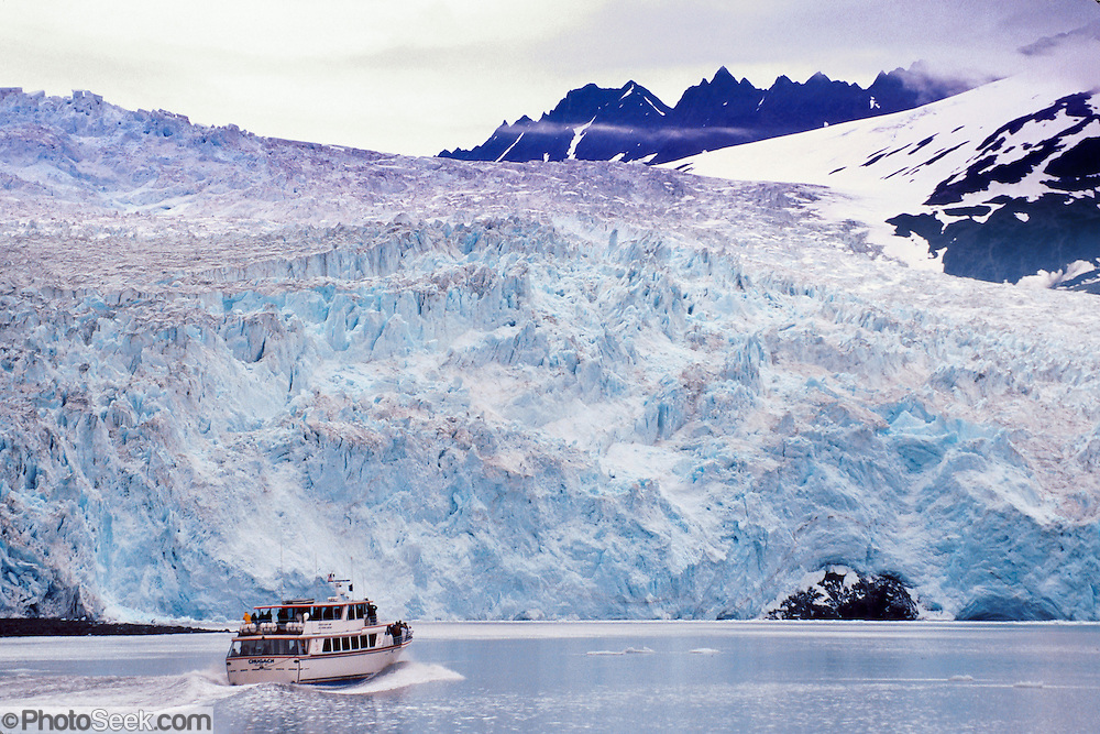 Tour Aialik Glacier in Aialik Bay via commercial boat in Kenai Fjords National Park, Alaska, USA. From Seward (130 miles south of Anchorage at the end of the Seward Highway), start your day cruise visiting Resurrection Bay, Aialik Bay, fjords, tidewater glaciers, and wildlife.